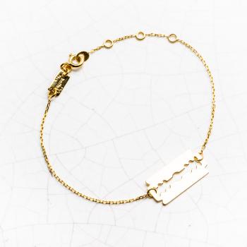 Bracelet lame de rasoir en Or orné d'une chaîne